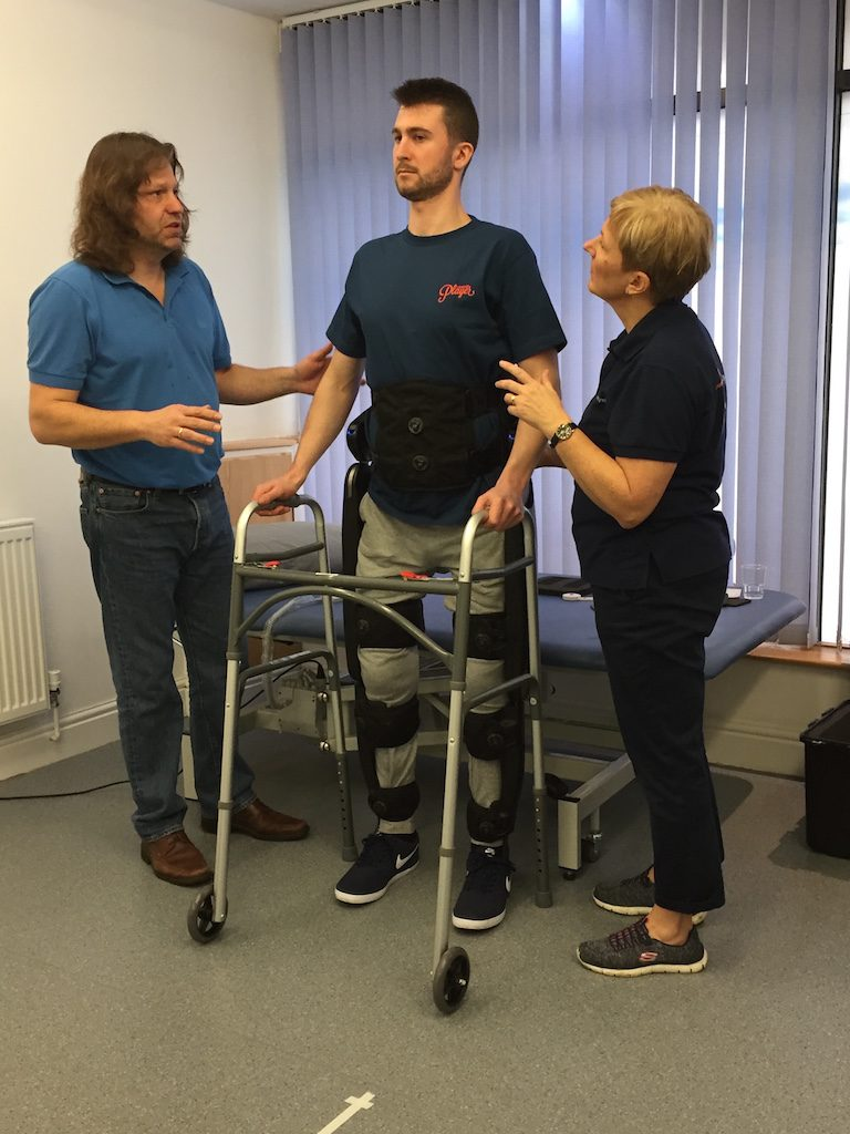 Henry standing in the Indego Exoskeleton